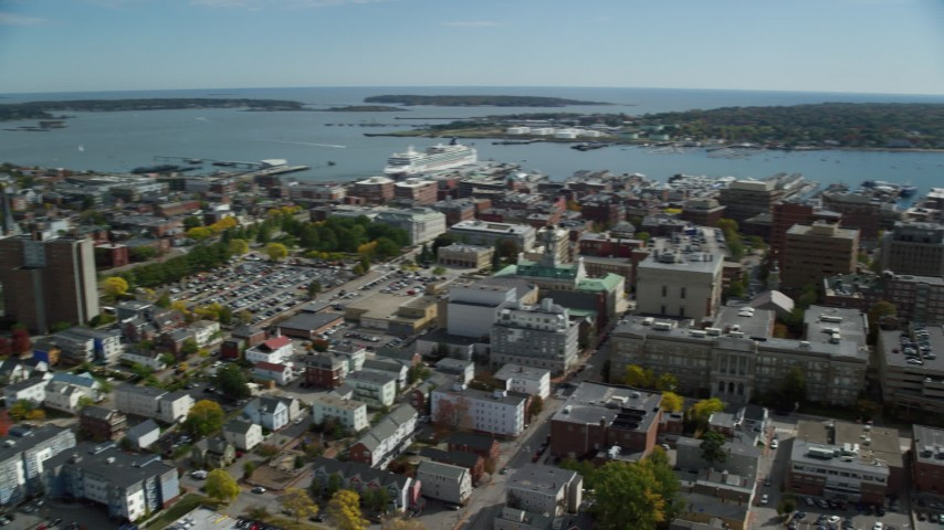 6k aerial video orbiting Portland Harbor, downtown buildings, autumn, Portland, Maine Aerial Stock Footage | AX147_330