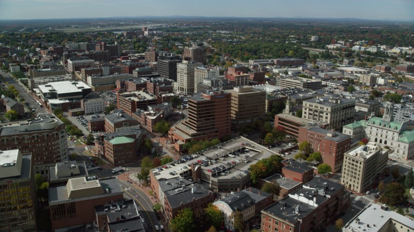 6k stock footage aerial video flying over downtown, approach Cumberland County Civic Center, Portland, Maine Aerial Stock Footage | AX147_333