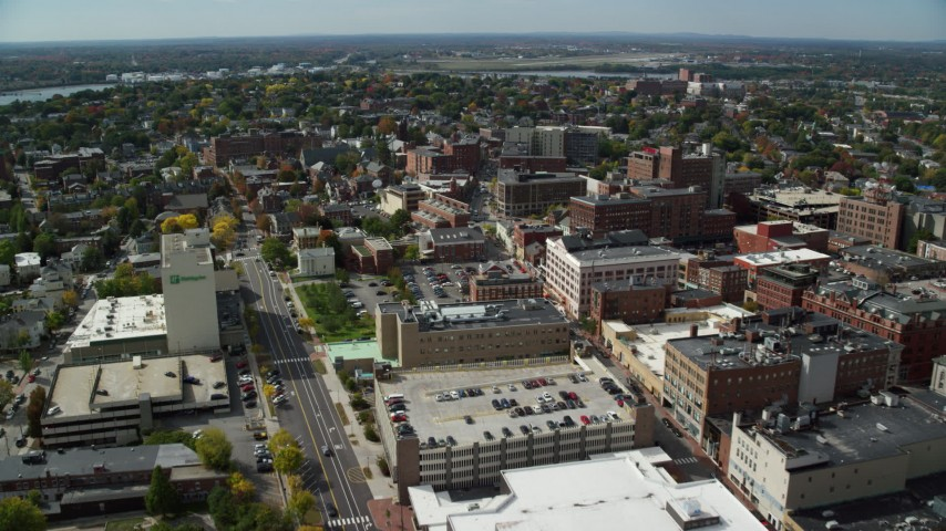 6k aerial video flying over downtown office buildings, autumn, Portland, Maine Aerial Stock Footage | AX147_334