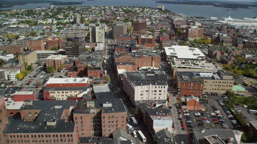 6k aerial video flying over Congress Street, approaching downtown buildings, Portland, Maine Aerial Stock Footage | AX147_338