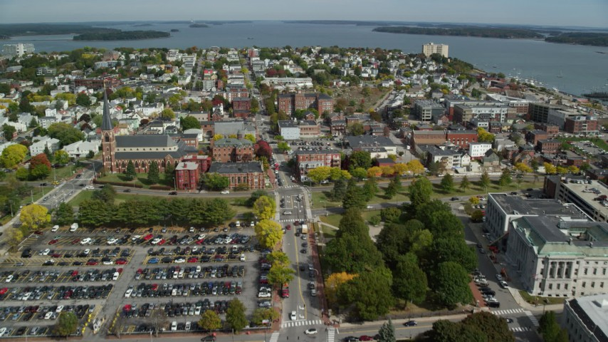 6k aerial video flying over downtown, approaching coastal town, autumn, Portland, Maine Aerial Stock Footage | AX147_339