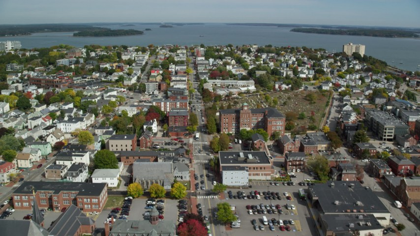 6k stock footage aerial video flying over a neighborhood approaching a coastal town, Portland, Maine Aerial Stock Footage | AX147_340