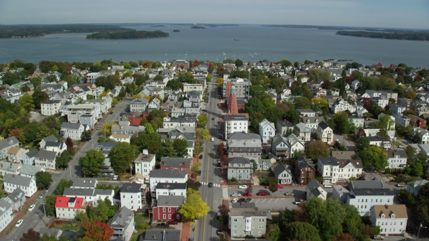6k aerial video flying over Congress Street to Portland Observatory, coastal town, Portland, Maine Aerial Stock Footage | AX147_341