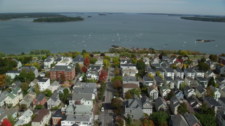 6k stock footage aerial video flying over coastal neighborhood to Eastern Promenade, bay,  Portland, Maine Aerial Stock Footage | AX147_342
