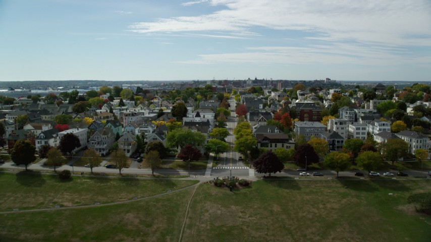 6k aerial video flying over Eastern Promenade, approach Congress Street, autumn, Portland, Maine Aerial Stock Footage AX147_347