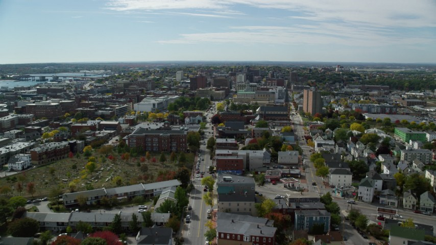 6k aerial video flying over Congress Street, approach Portland City Hall and a cathedral, Portland, Maine Aerial Stock Footage AX147_349