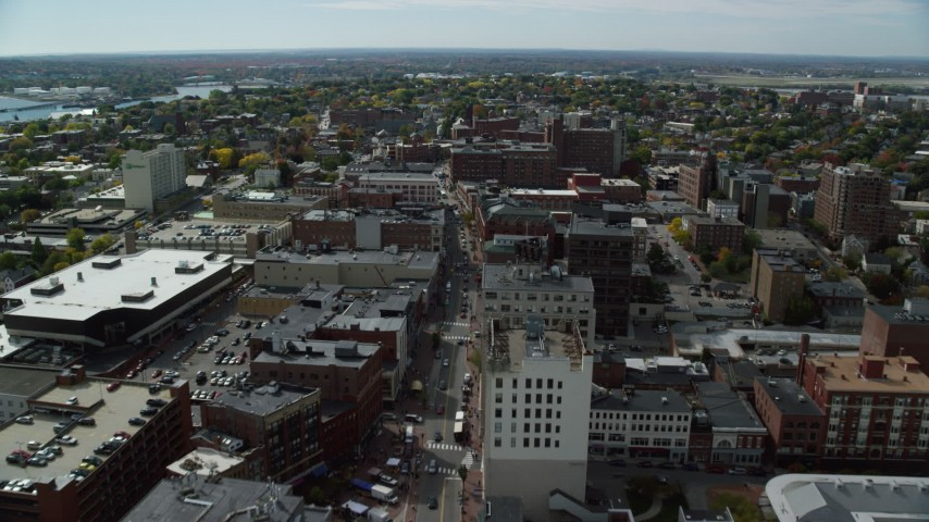 6k aerial video flying over Congress Street, approaching hotel and tv station, autumn, Portland, Maine Aerial Stock Footage | AX147_351