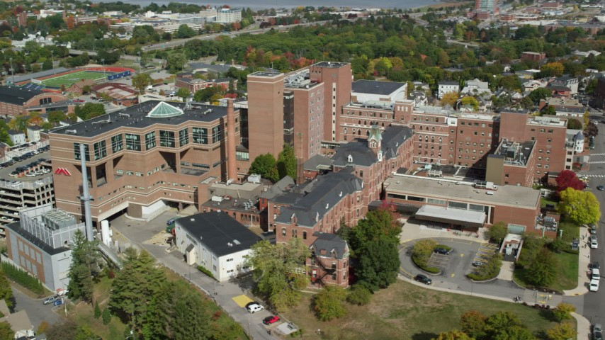 6k aerial video orbiting Maine Medical Center, autumn, Portland, Maine Aerial Stock Footage | AX147_354