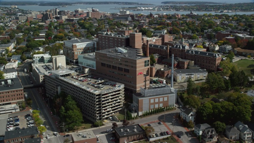 6k aerial video orbiting the Maine Medical Center, autumn, Portland, Maine Aerial Stock Footage | AX147_355