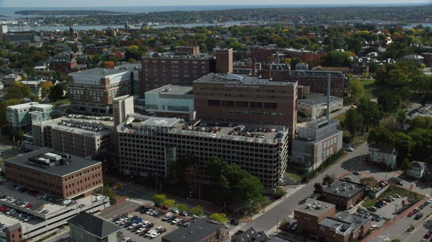 6k stock footage aerial video orbiting Maine Medical Center, autumn, Portland, Maine Aerial Stock Footage | AX147_356
