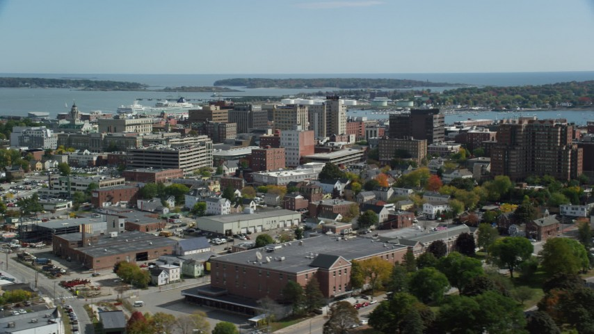 6k aerial video flying by downtown, office buildings, autumn, Portland, Maine Aerial Stock Footage | AX147_358