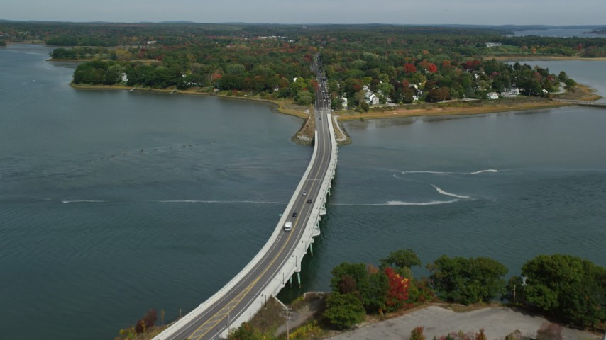 6k stock footage aerial video flying over Martin Point Bridge, approach coastal neighborhood, autumn, Falmouth, Maine Aerial Stock Footage | AX147_362