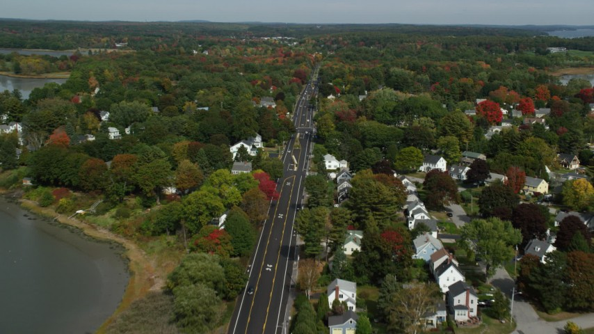 6k stock footage aerial video flying over Route 1, approach coastal neighborhood, autumn, Falmouth, Maine Aerial Stock Footage | AX147_363
