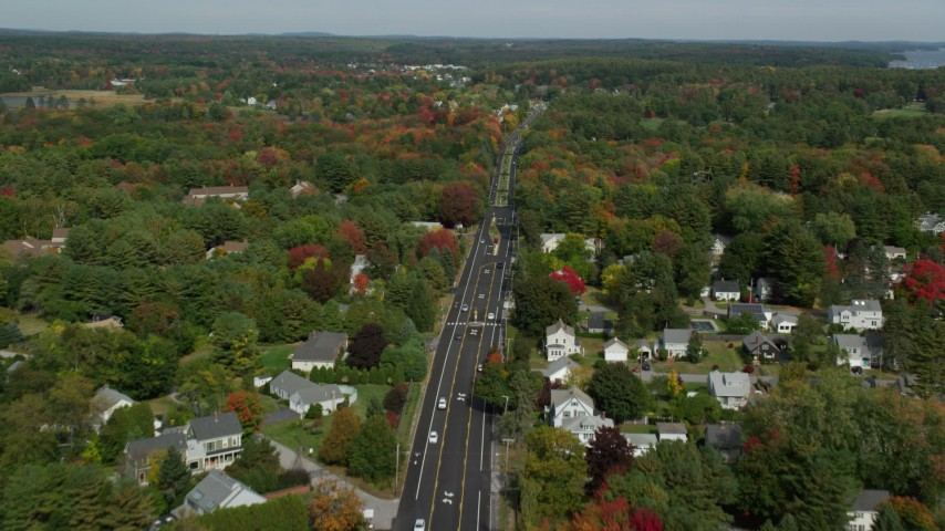 6k stock footage aerial video flying over Route 1 through neighborhood, autumn, Falmouth, Maine Aerial Stock Footage AX147_364