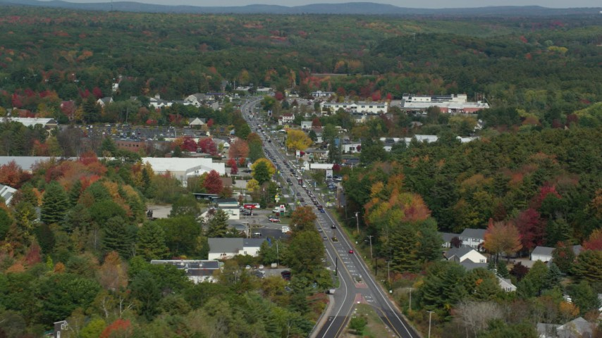 6k stock footage aerial video flying by Route 1, small town in autumn, Falmouth, Maine Aerial Stock Footage | AX147_365
