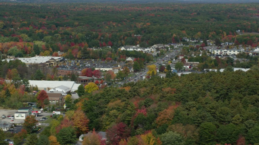 6k stock footage aerial video flying by strip malls, small town in autumn, Falmouth, Maine Aerial Stock Footage | AX147_366