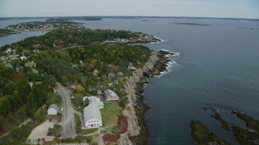6k stock footage aerial video flying by coastal town, Bailey Island in autumn, Harpswell, Maine Aerial Stock Footage | AX147_378