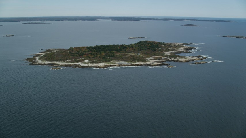 6k stock footage aerial video approaching an isolated house, Ragged Island, autumn, Harpswell, Maine Aerial Stock Footage | AX147_380