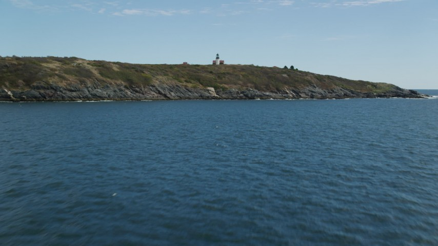 6k stock footage aerial video approaching  Seguin Island, tilting up to reveal Seguin Light, Phippsburg, Maine Aerial Stock Footage   AX147_388