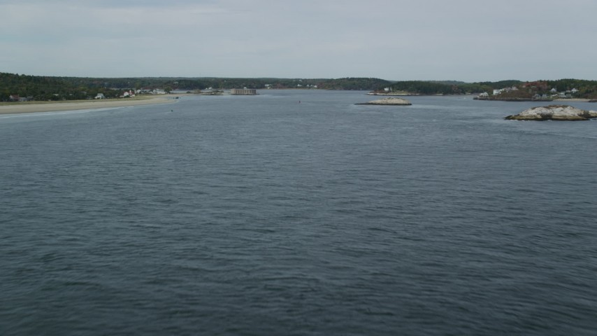 6k stock footage aerial video flying over Kennebec River, approach North Sugarloaf Island, Phippsburg, Maine Aerial Stock Footage | AX147_396