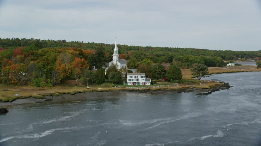 6k stock footage aerial video of Phippsburg Congregational Church, waterfront home, autumn, Phippsburg, Maine Aerial Stock Footage   AX147_404