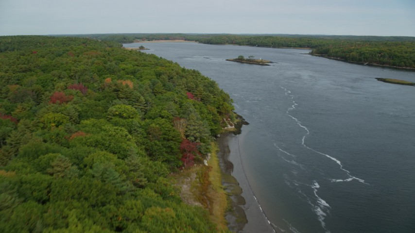 6k stock footage aerial video flying over forest, Kennebec River, approach Ram Island, autumn, Phippsburg, Maine Aerial Stock Footage | AX147_405