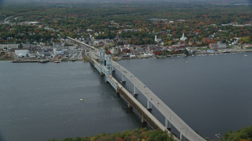 6k aerial video flying by Sagadohoc Bridge, small town, autumn, Bath, Maine Aerial Stock Footage | AX147_413
