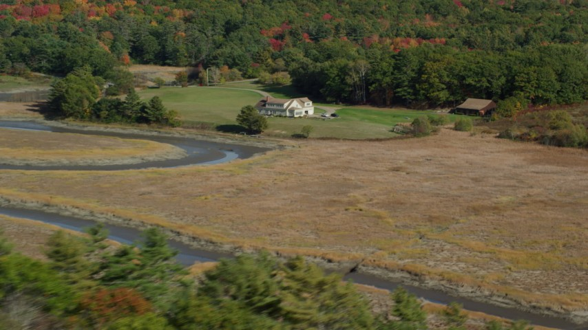 6k stock footage aerial video flying by an isolated rural home, colorful forest, autumn, Newcastle, Maine Aerial Stock Footage | AX148_010