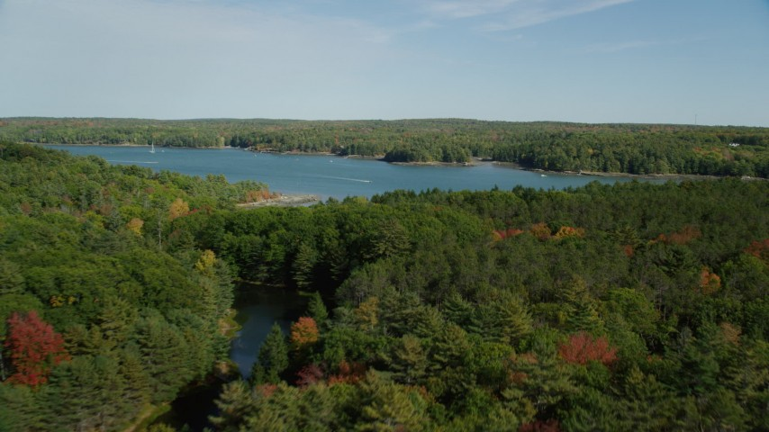 6k stock footage aerial video flying over colorful forest, approach Damariscotta River, autumn, Newcastle, Maine Aerial Stock Footage | AX148_014