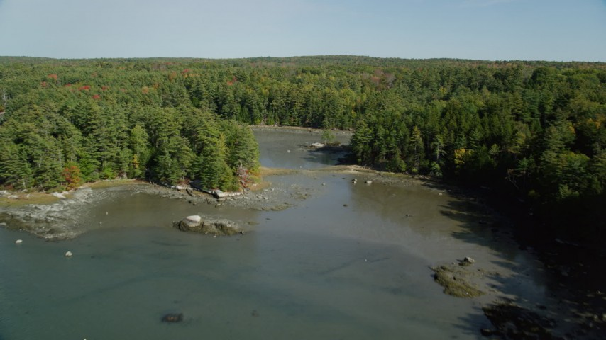 6k aerial video flying over Damariscotta River, forest, isolated homes, autumn, Damariscotta, Maine Aerial Stock Footage | AX148_016