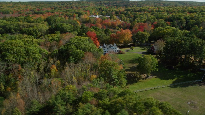 6k aerial video approaching an isolated home, colorful forest, autumn, Damariscotta, Maine Aerial Stock Footage | AX148_017