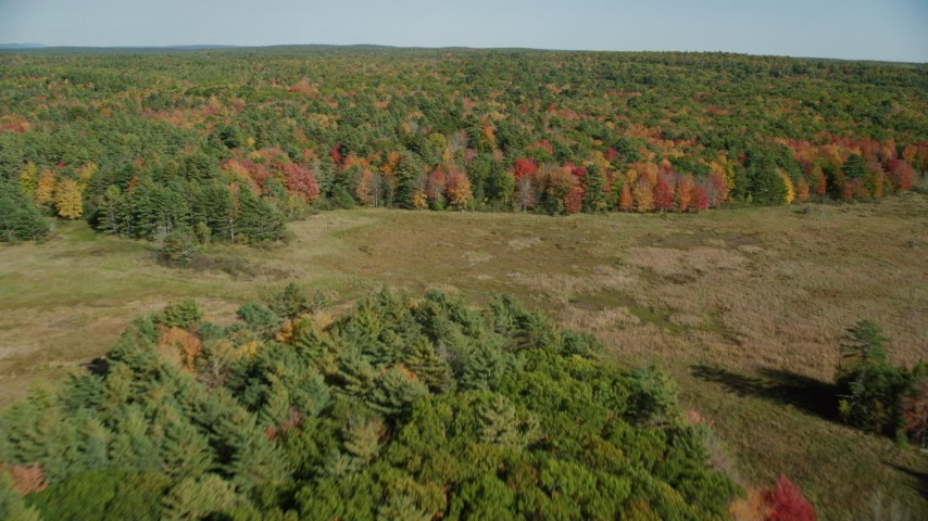 6k aerial video approaching, flying over a colorful forest, autumn, Damariscotta, Maine Aerial Stock Footage | AX148_018