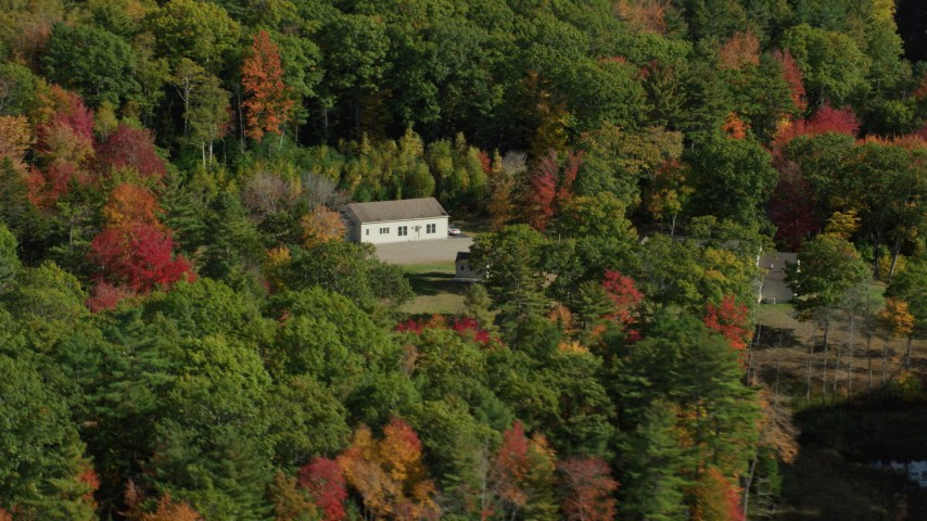 6k aerial video flying by an isolated rural homes, colorful trees, autumn, Damariscotta, Maine Aerial Stock Footage | AX148_021