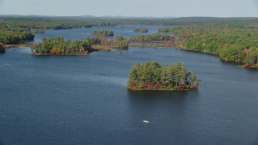 6k aerial video of forests on small islands, Pemaquid Pond, McCurdy Pond, autumn, Damariscotta, Maine Aerial Stock Footage AX148_025