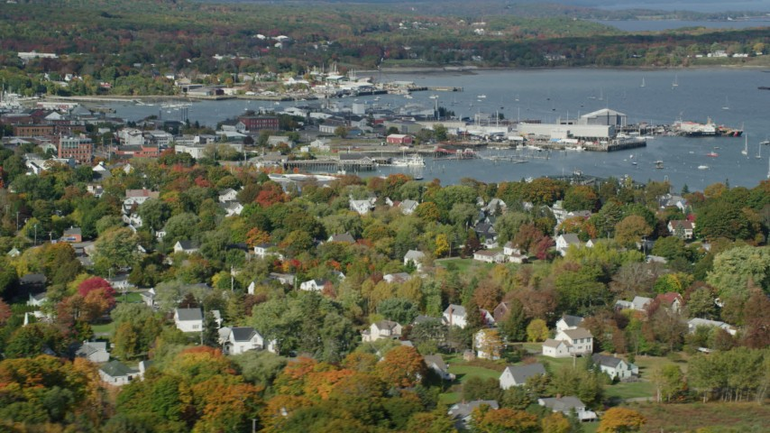 6k stock footage aerial video flying by Rockland Harbor, small coastal town, autumn, Rockland, Maine Aerial Stock Footage | AX148_077