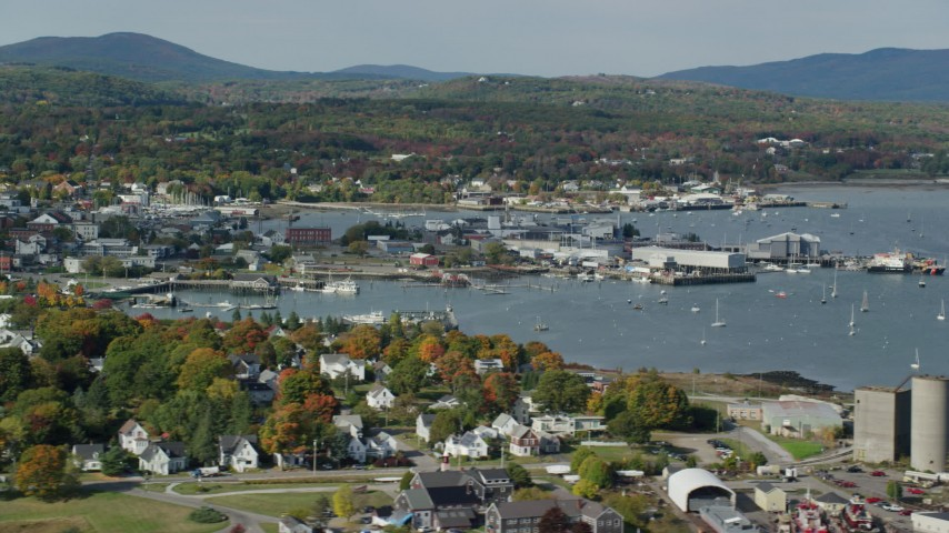 6k stock footage aerial video flying by Rockland Harbor, small coastal town, autumn, Rockland, Maine Aerial Stock Footage | AX148_078