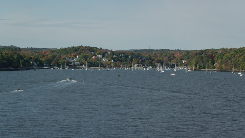 6k stock footage aerial video flying low, approaching Lockport Harbor, small coastal town, autumn, Rockport, Maine Aerial Stock Footage | AX148_092