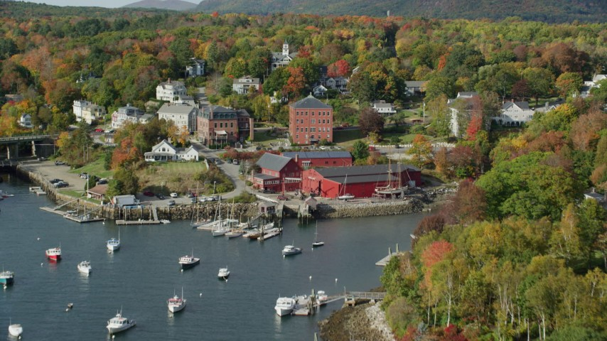 6k stock footage aerial video flying over boats, Rockport Harbor, approach small coastal town, Rockport, Maine Aerial Stock Footage | AX148_094