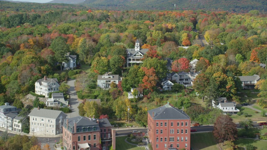 6k stock footage aerial video flying over small town, approaching colorful forest, autumn, Rockport, Maine Aerial Stock Footage | AX148_095