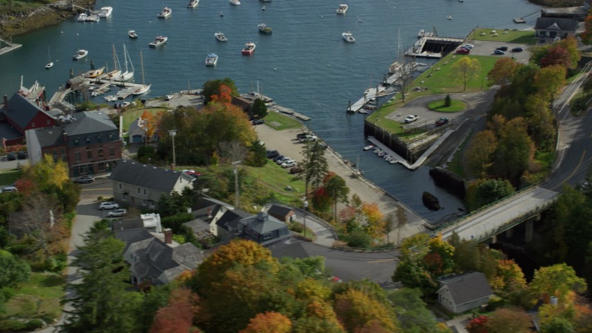 6k stock footage aerial video orbiting small coastal town, Rockport Harbor, autumn, Rockport, Maine Aerial Stock Footage | AX148_096