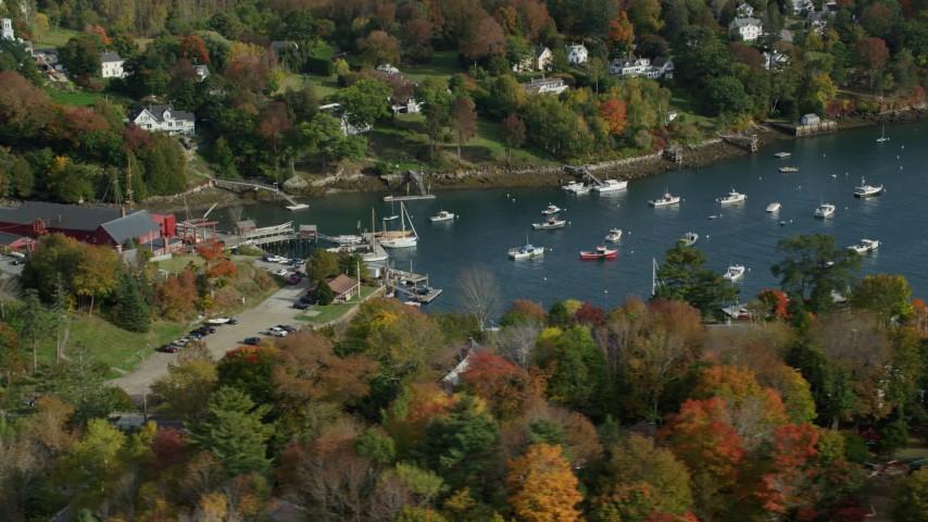 6k stock footage aerial video orbiting small coastal town, Rockport Harbor, autumn, Rockport, Maine Aerial Stock Footage | AX148_097