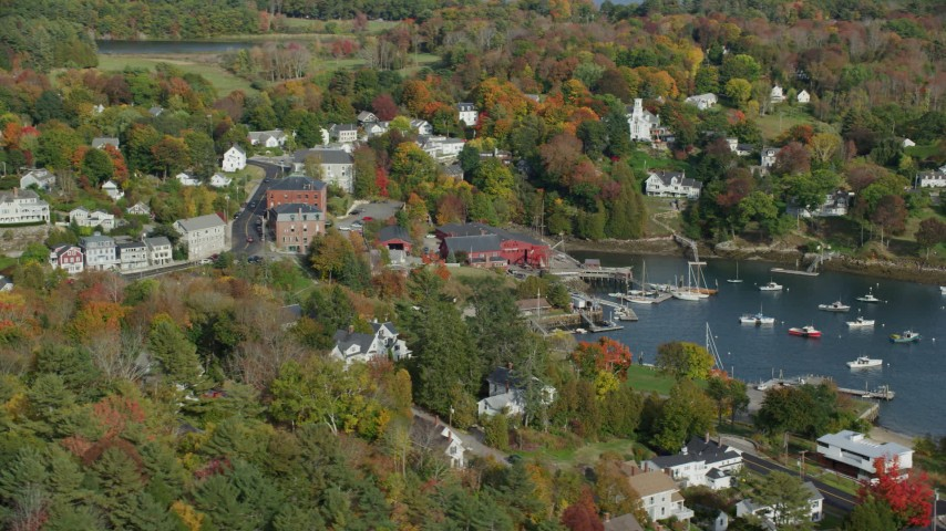 6k stock footage aerial video orbiting small coastal town, Rockport Harbor, autumn, Rockport, Maine Aerial Stock Footage | AX148_098