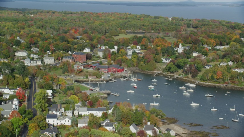 6k stock footage aerial video orbiting small coastal town, Rockport Harbor, autumn, Rockport, Maine Aerial Stock Footage AX148_099 | Axiom Images