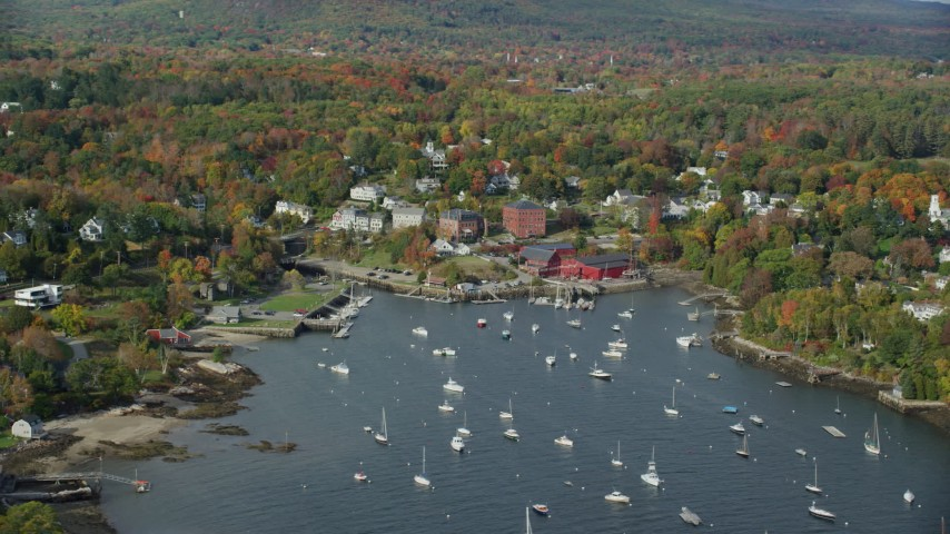 6k stock footage aerial video orbiting small coastal town, Rockport Harbor, autumn, Rockport, Maine Aerial Stock Footage | AX148_100