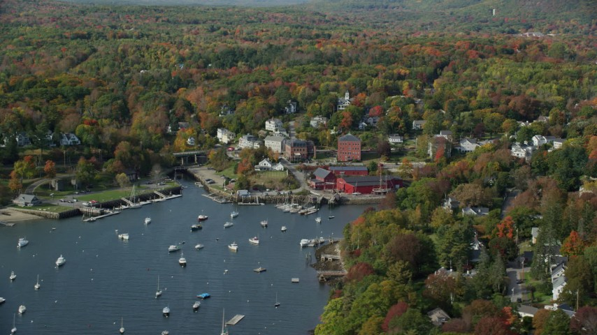 6k stock footage aerial video orbiting a small coastal town and harbor in autumn, Rockport, Maine Aerial Stock Footage | AX148_101
