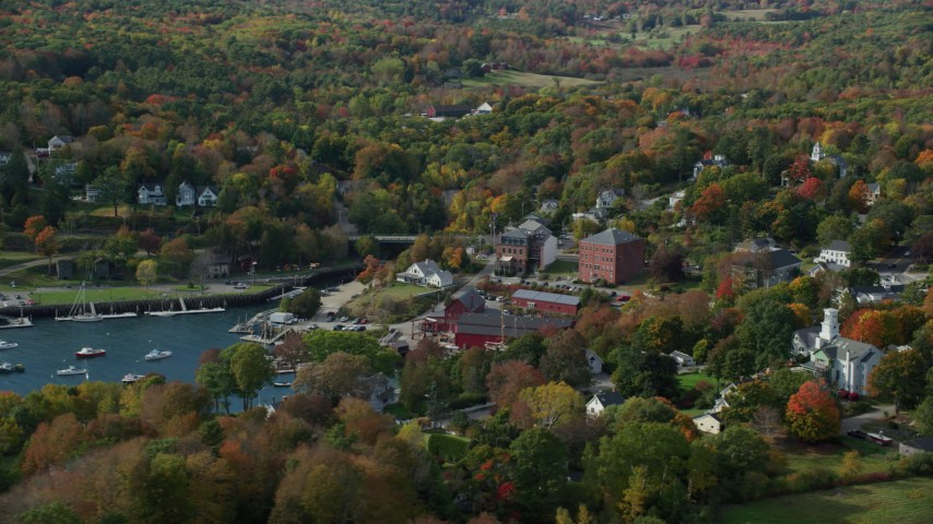 6k stock footage aerial video flying by a small coastal town, autumn, Rockport, Maine Aerial Stock Footage | AX148_102