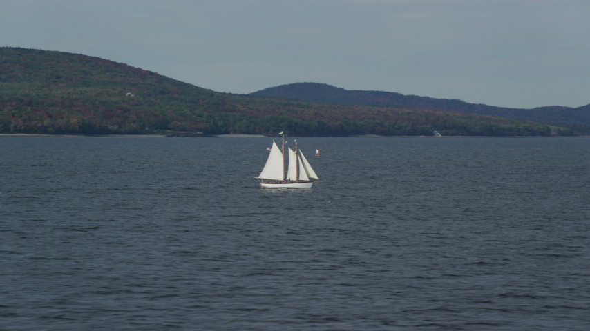 6k stock footage aerial video tracking a sailboat, West Penobscot Bay, autumn, Rockport, Maine Aerial Stock Footage | AX148_104