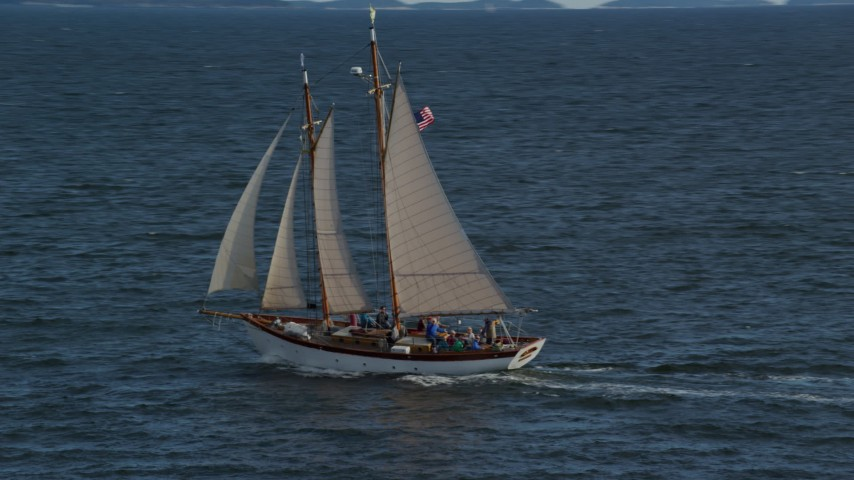 6k stock footage aerial video orbiting a sailboat on West Penobscot Bay, Rockport, Maine Aerial Stock Footage | AX148_107
