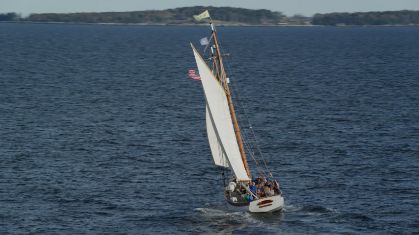 6k aerial video orbiting a sailboat on West Penobscot Bay, Rockport, Maine Aerial Stock Footage | AX148_108