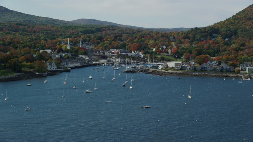 6k aerial video approaching Camden Harbor, small coastal town, autumn, Camden, Maine Aerial Stock Footage | AX148_110